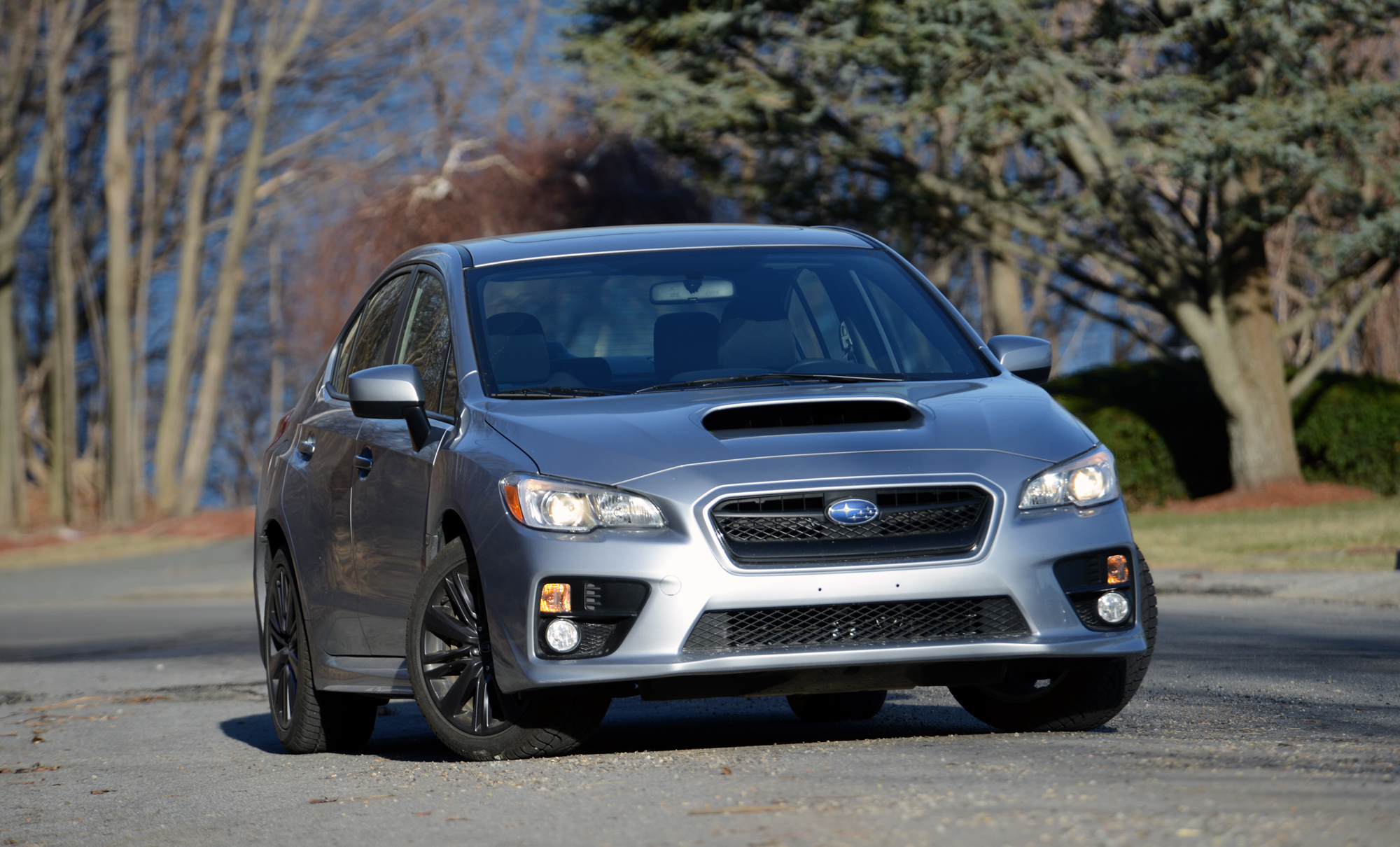 A silver Subaru WRX sedan, the perfect car for winter 2021, shot from the front on a winter day