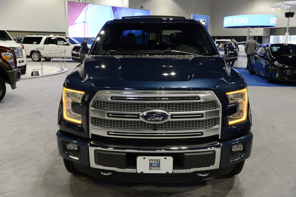 A blue 2016 Ford F-150 at an auto show