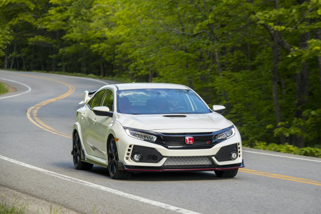 2017 Honda Civic Type R in championship white driving on a road