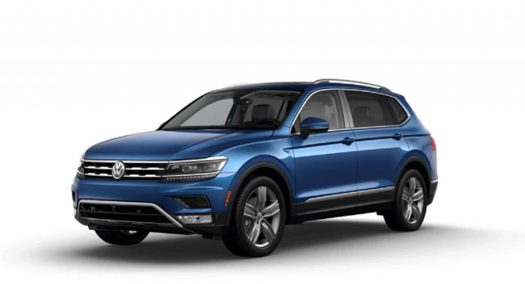 A blue 2021 Volkswagen Tiguan against a white background.