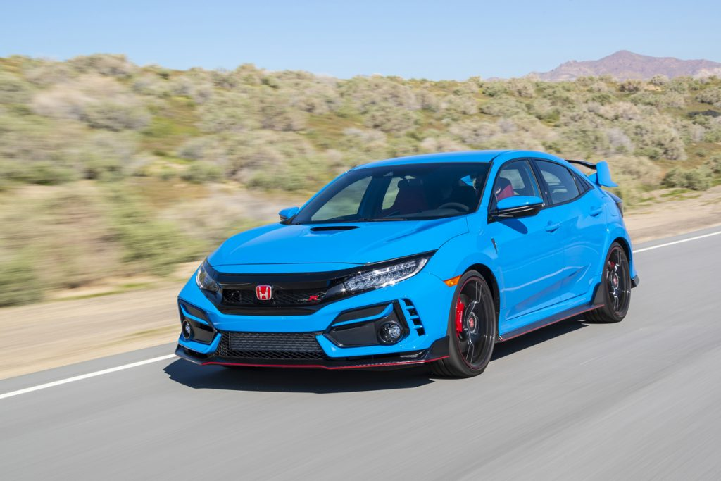 2020 Honda Civic Type R in Boost Blue driving down a road