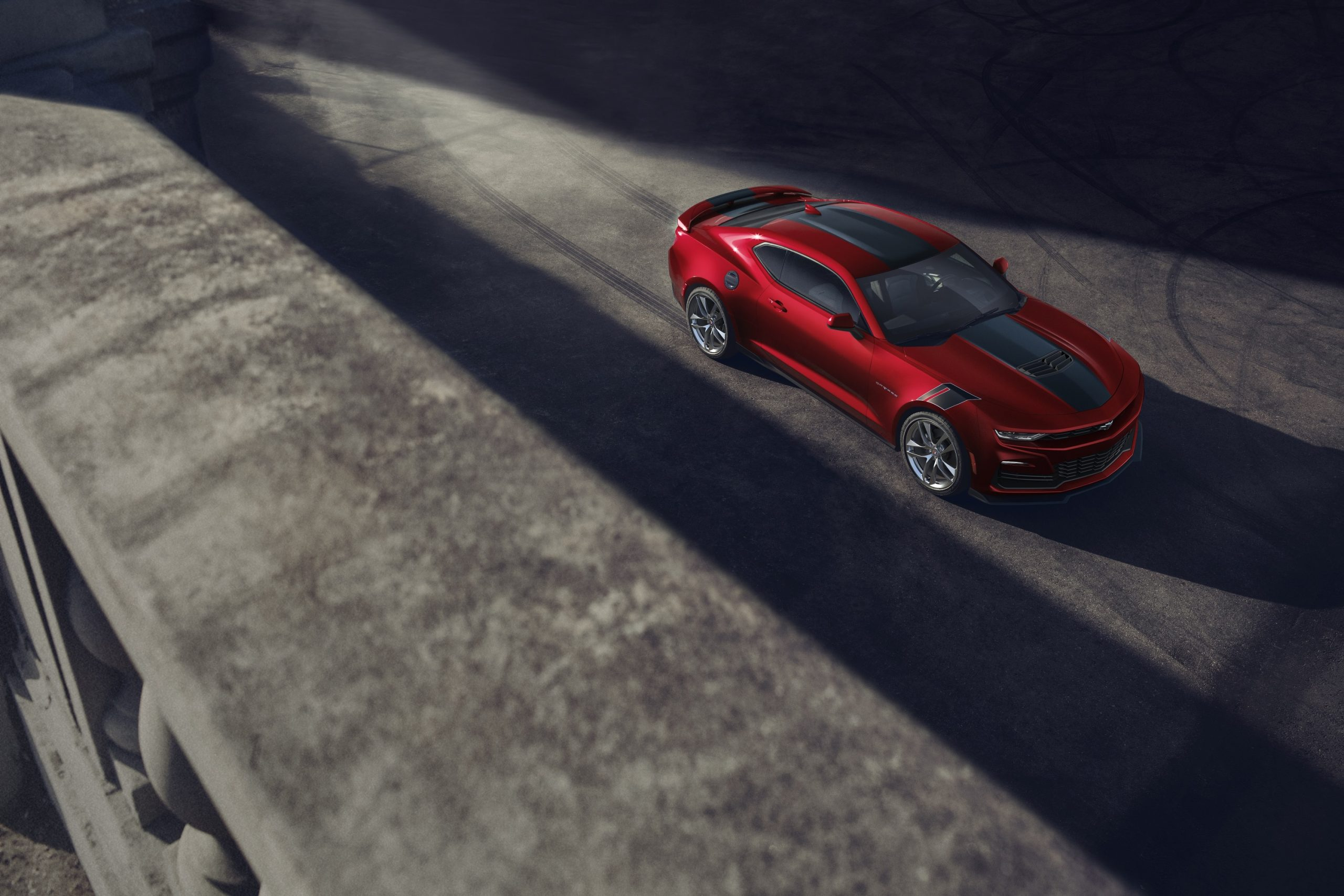 The 2021 Chevrolet Camaro SS taken from the high 3/4 angle in a warehouse