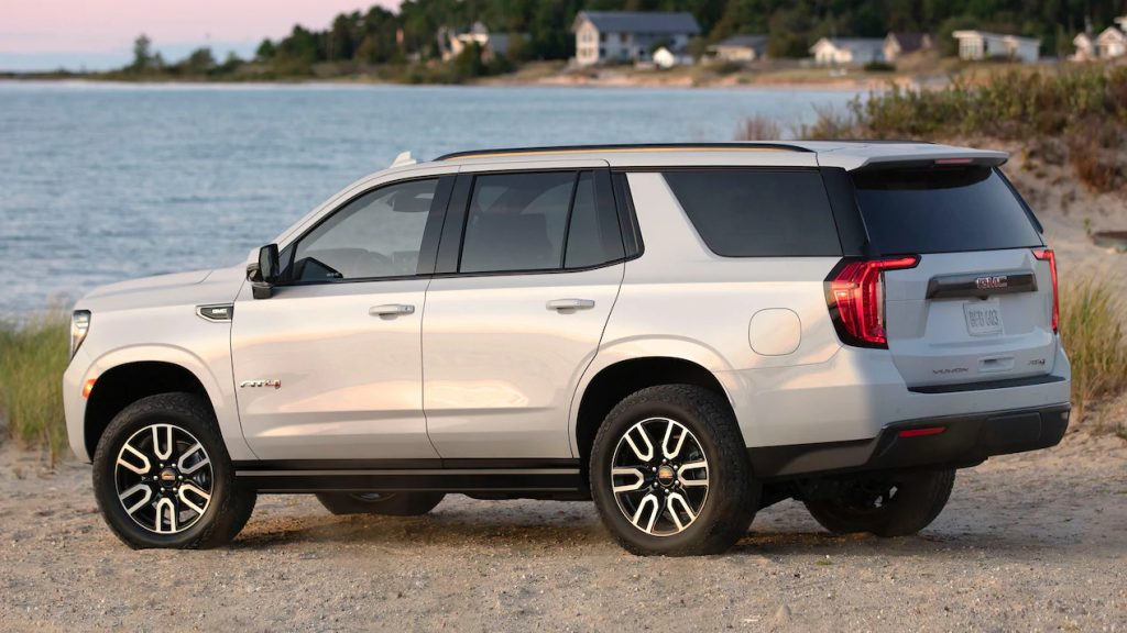 A 2021 GMC Yukon AT4 parked on the beach near water
