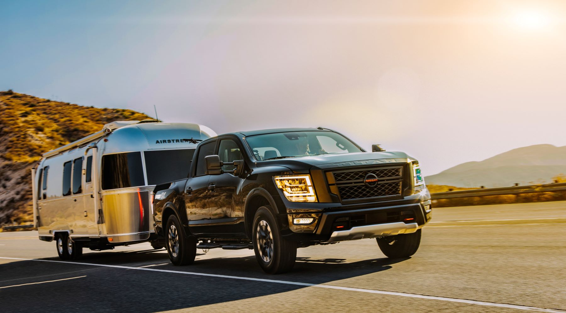 The 2021 Nissan Titan full-size pickup truck towing an Airstream trailer