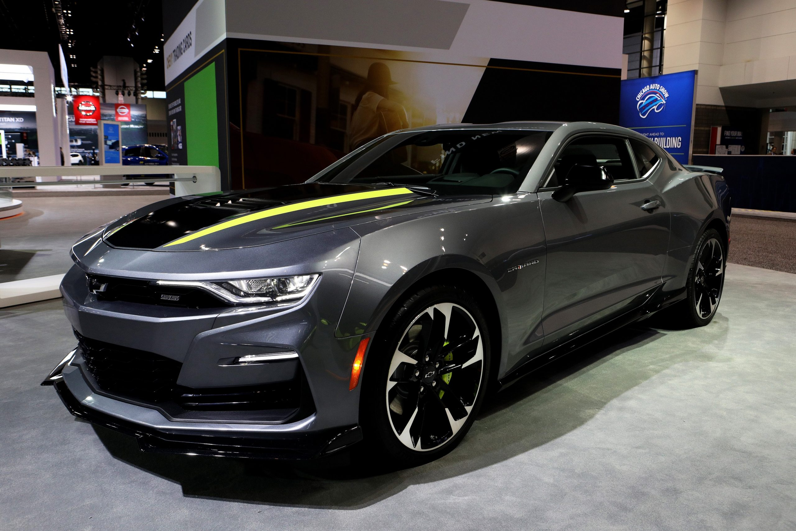 A grey Chevrolet Camaro shot from the 3/4 angle at an auto show