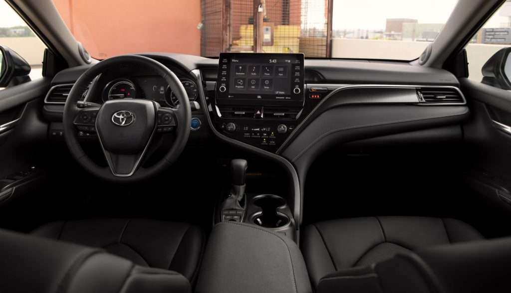 a black interior on the 2021 Toyota Camry Hybrid XSE