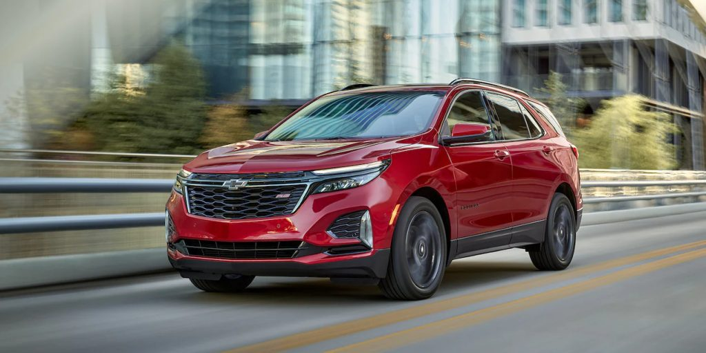 A red 2022 Chevrolet Equinox driving on the road