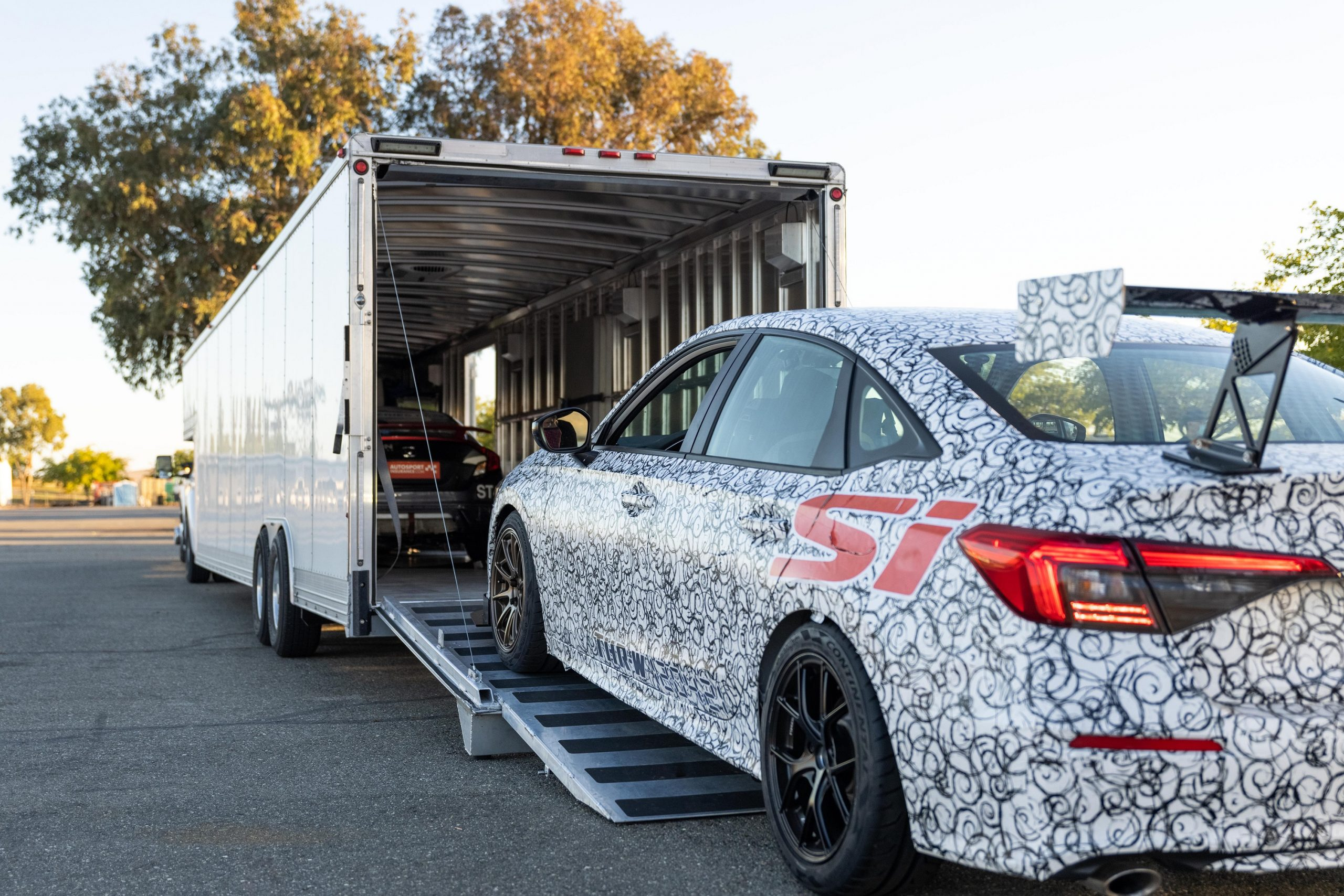 The 2022 Honda Civic Si gets loaded onto a trailer