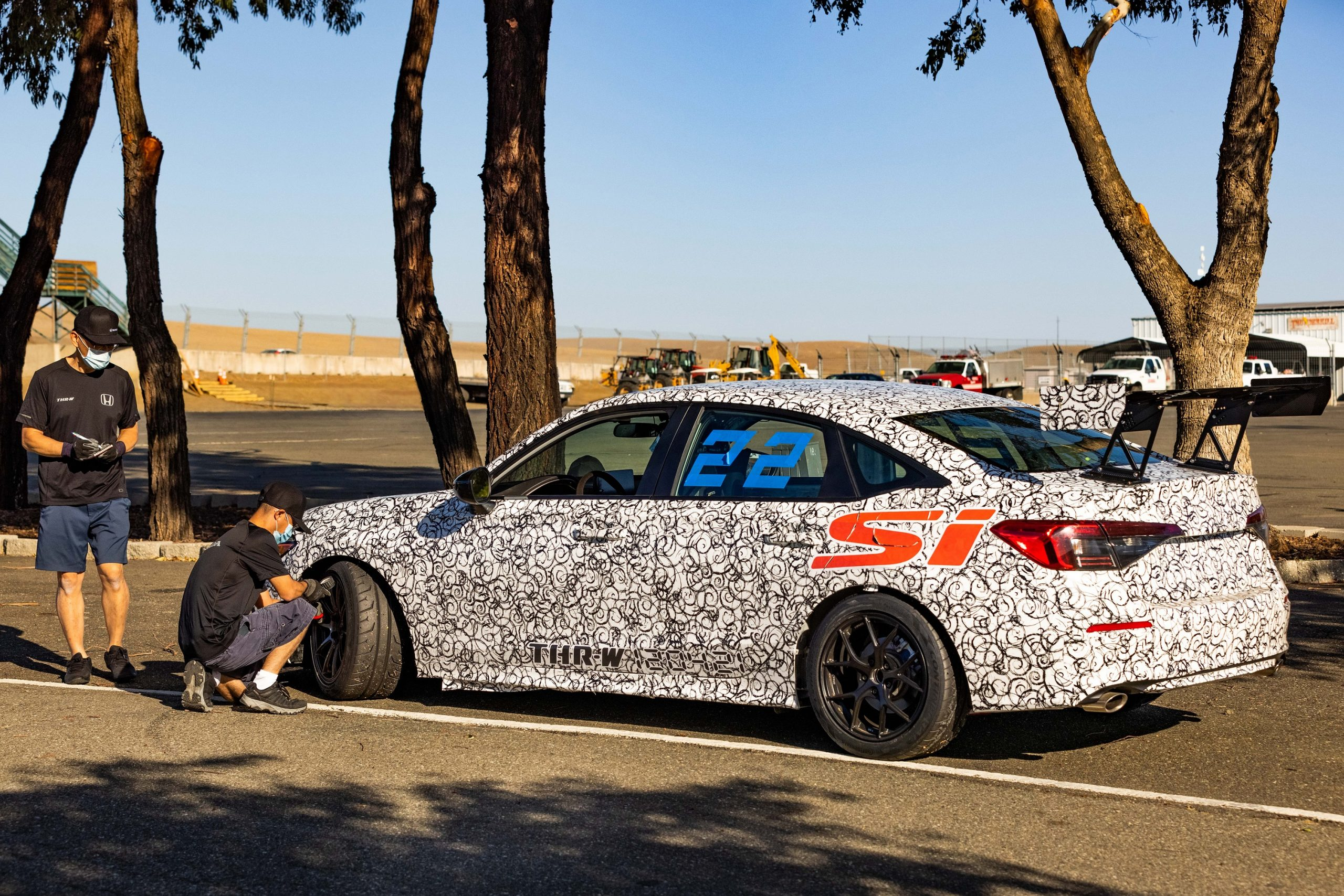 The white camo 2022 Civic Si gets its tires changed at a race track