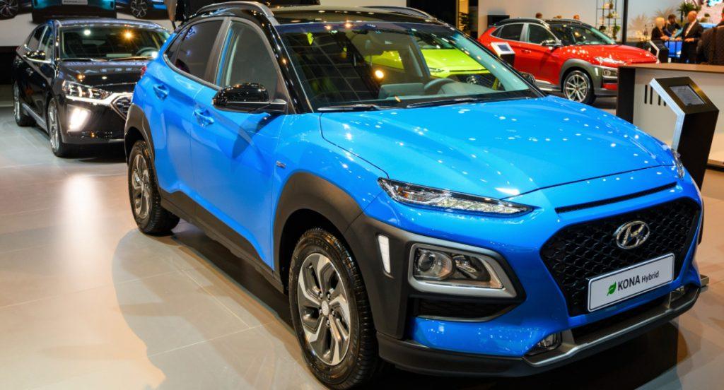 A blue Hyundai Kona is on display.