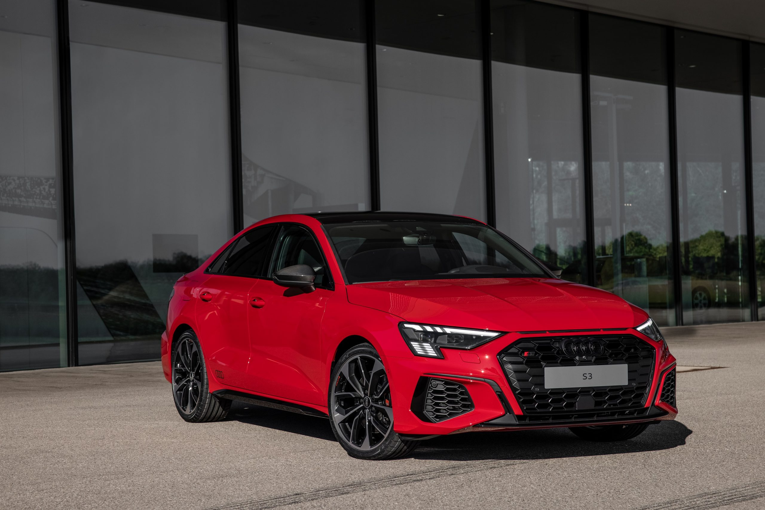 A red 2022 Audi S3 shot from the 3/4 angle
