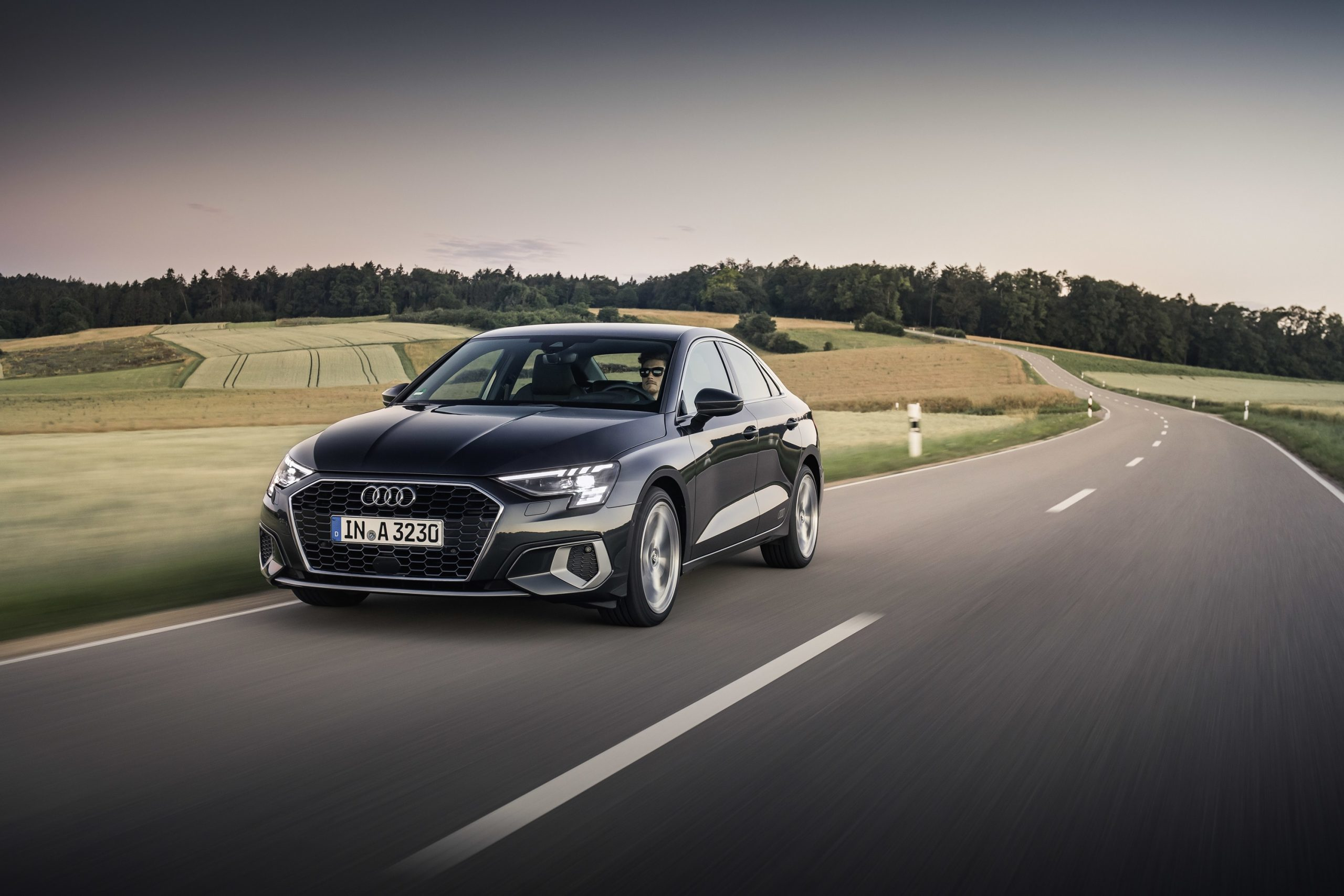 The 2022 Audi A3 in grey on a country road, shot from the 3/4 angle