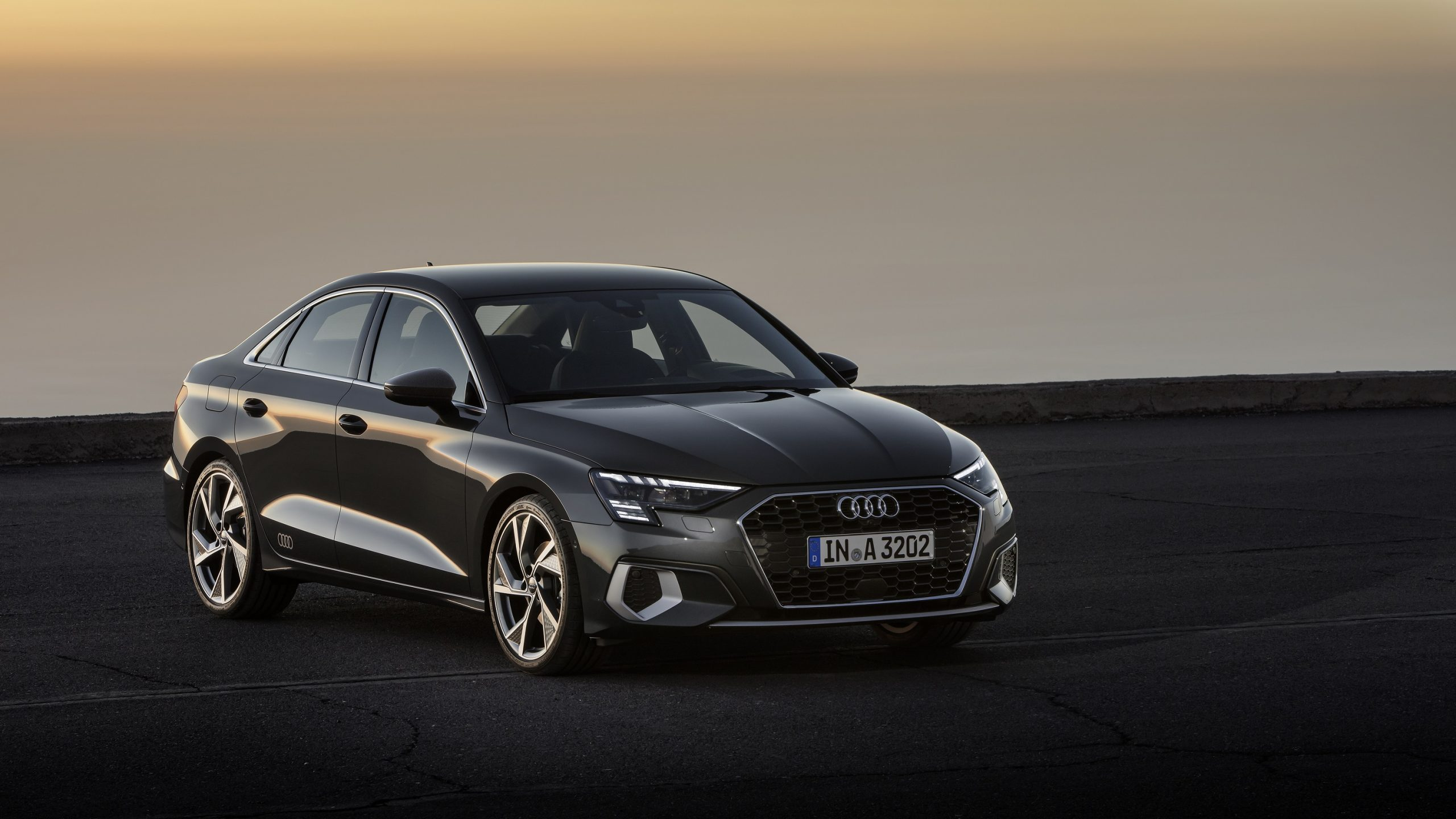 A grey 2022 Audi A3 shot at sunset from the 3/4 angle