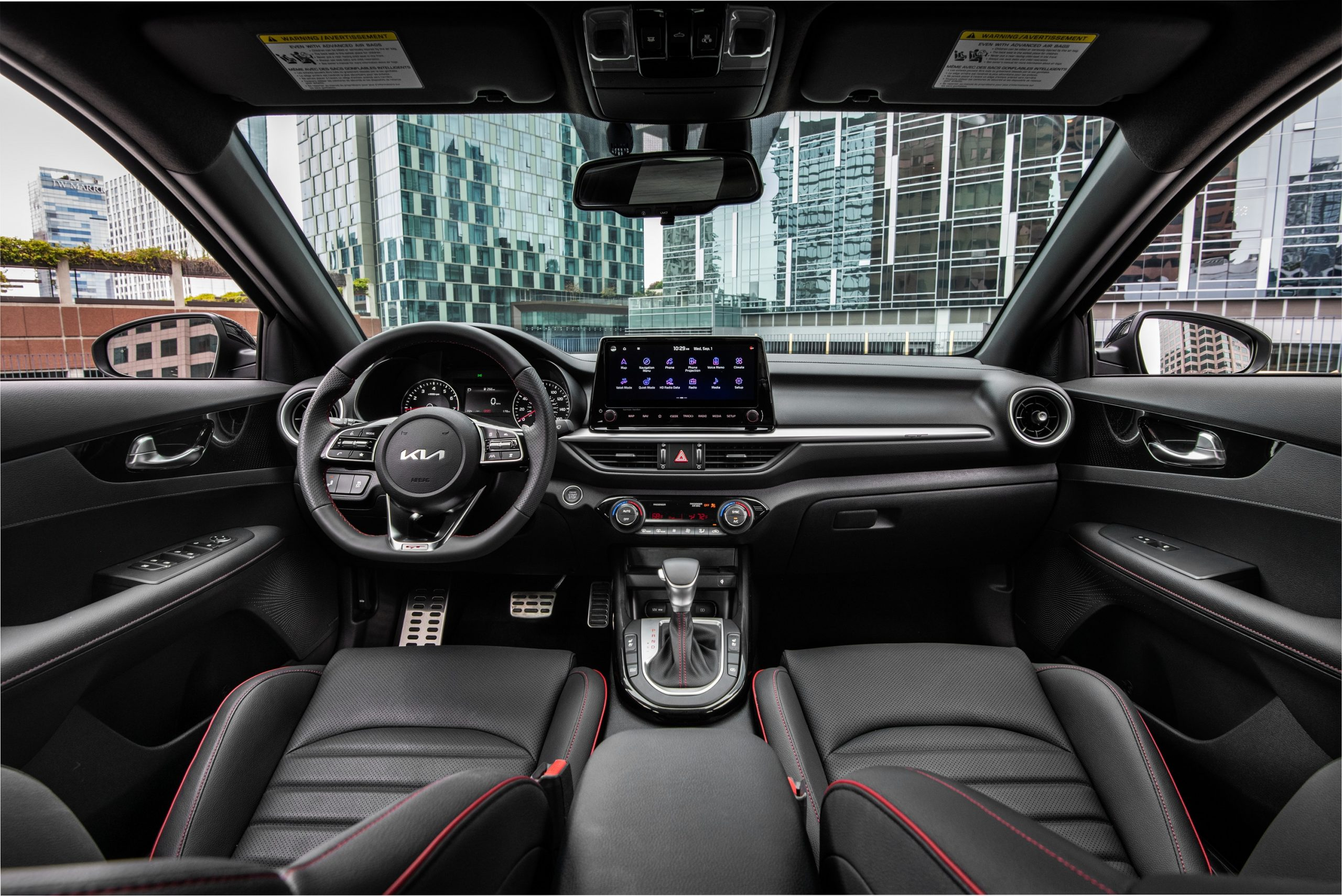 The interior of the new Forte with black leather seats and contrast red stitching