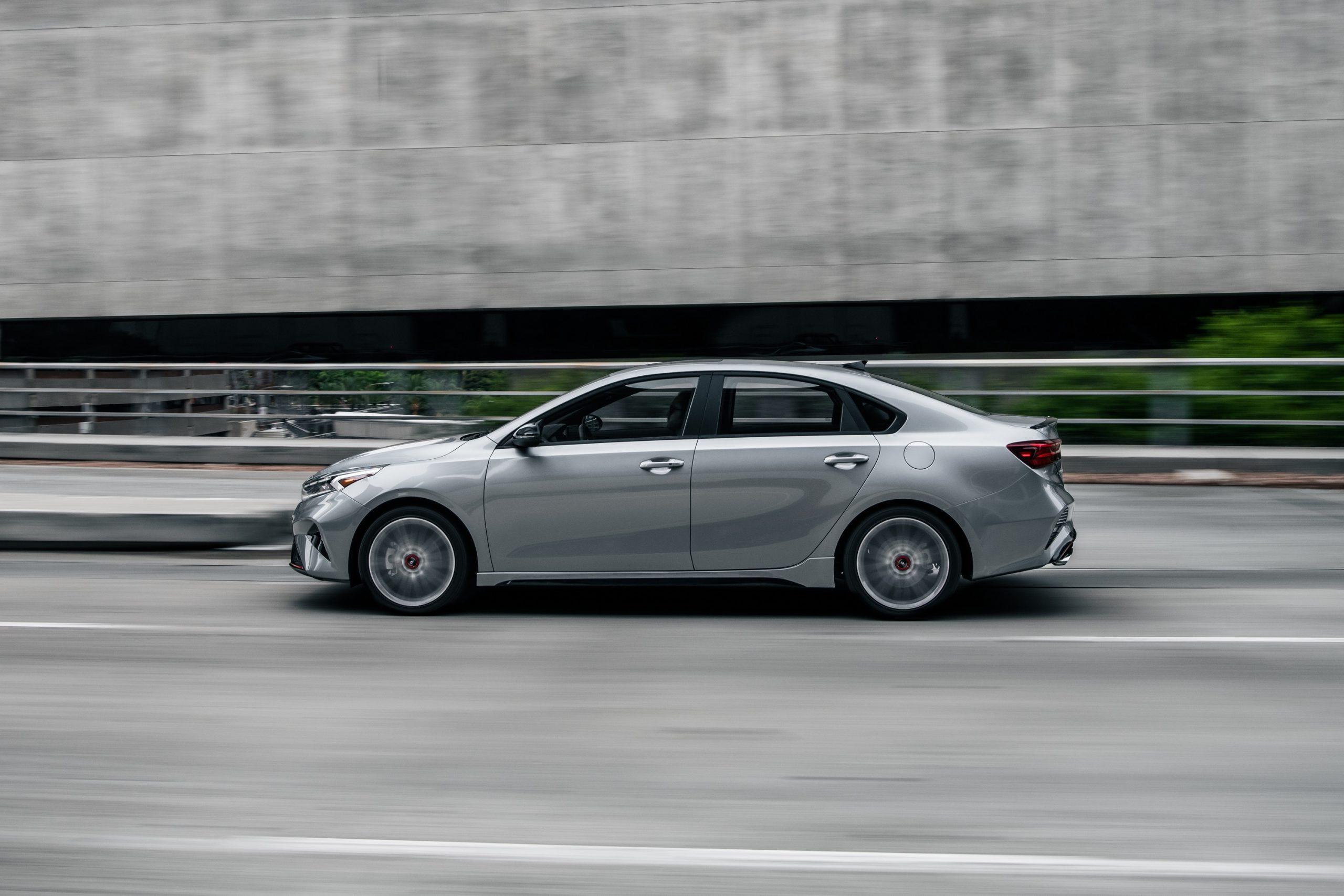 A silver 2022 Kia Forte shot in profile