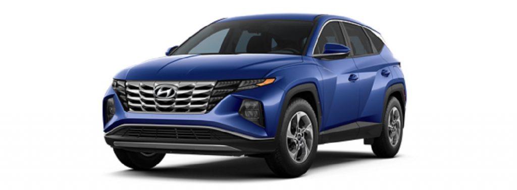 A blue 2022 Hyundai Tucson against a white background.