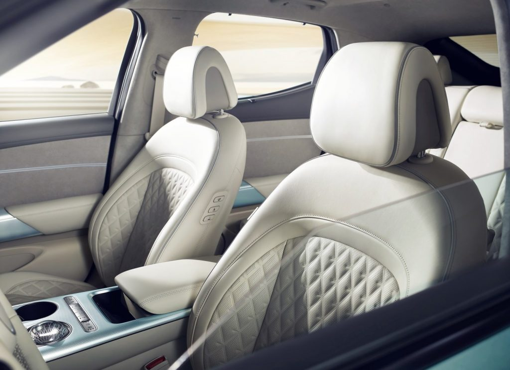The interior of a 2023 Genesis GV60, lightly colored with luxurious features