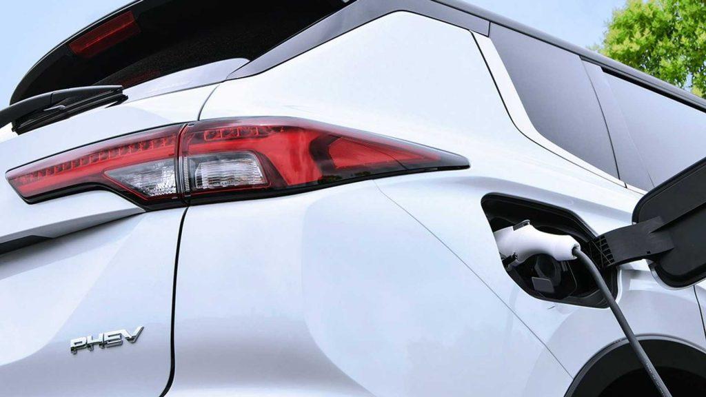 White 2023 Mitsubishi Outlander Plug-in hybrid plugged in