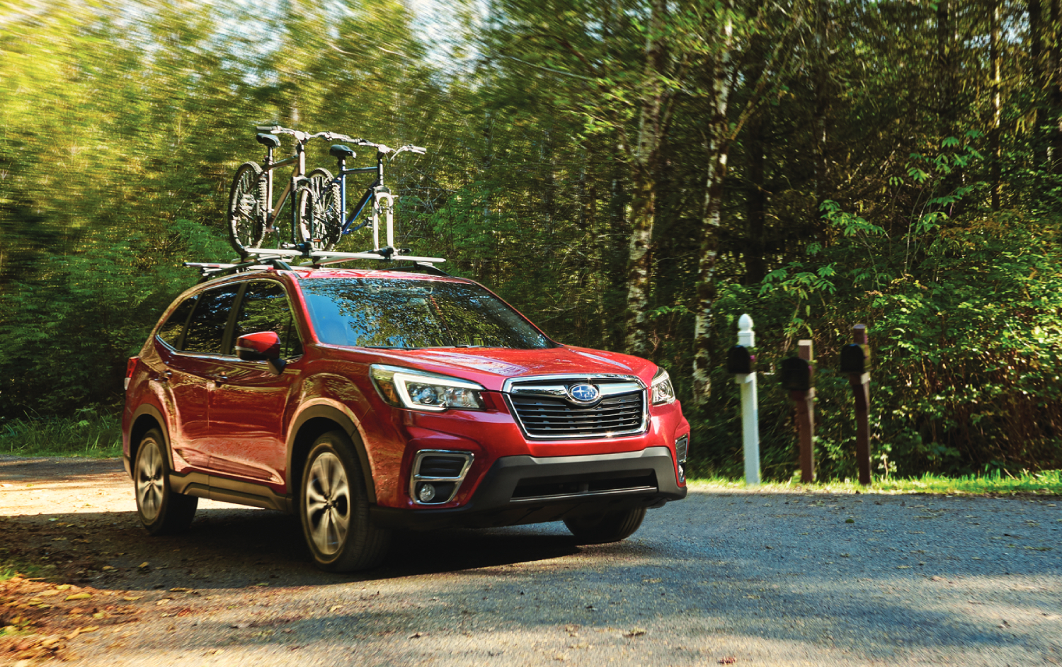 Red 2021 Subaru Forester with two bikes on top, the Forester is one of the best SUVs under $30,000