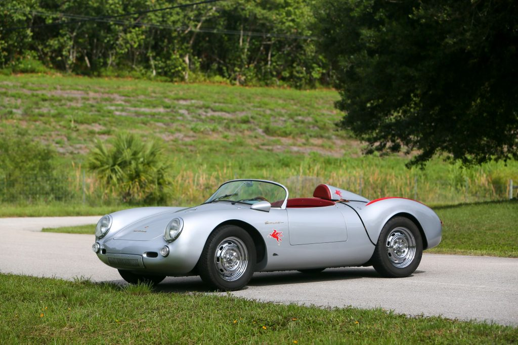A silver-with-red-badging Beck 550 Spyder Replica by Chamonix Karosserie on a country road