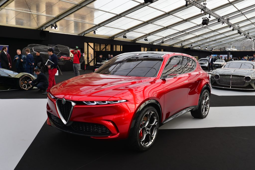 A red Alfa Romeo Tonale concept model displayed at the Paris Festival Automobile International with concept cars and automotive design exhibition.