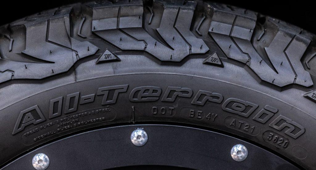 A black All-Terrain tire.