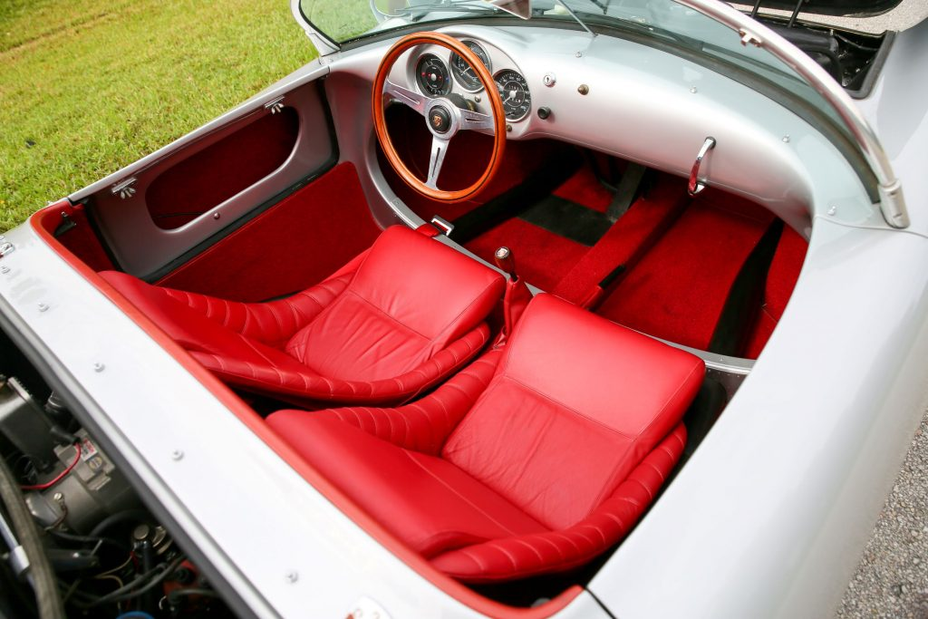 The red-leather seats and silver dashboard of a silver Beck 550 Spyder Replica by Chamonix Karosserie