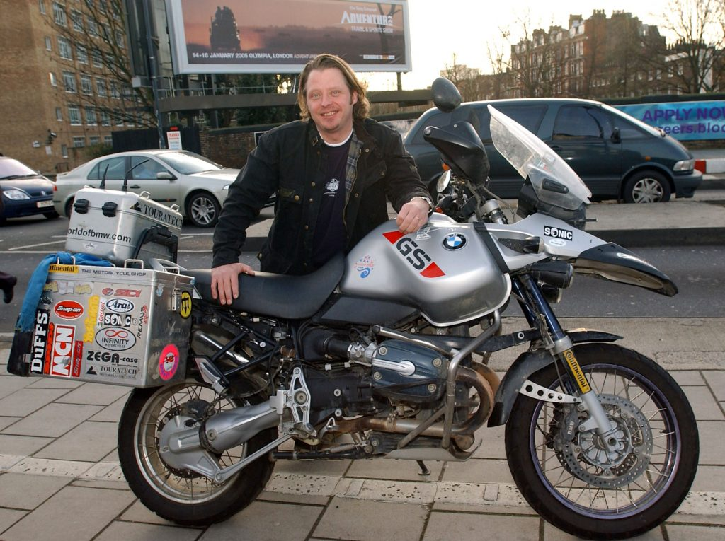 """Charley Boorman with his silver """"Long Way Round"""" BMW R 1150 GS Adventure motorcycle"""