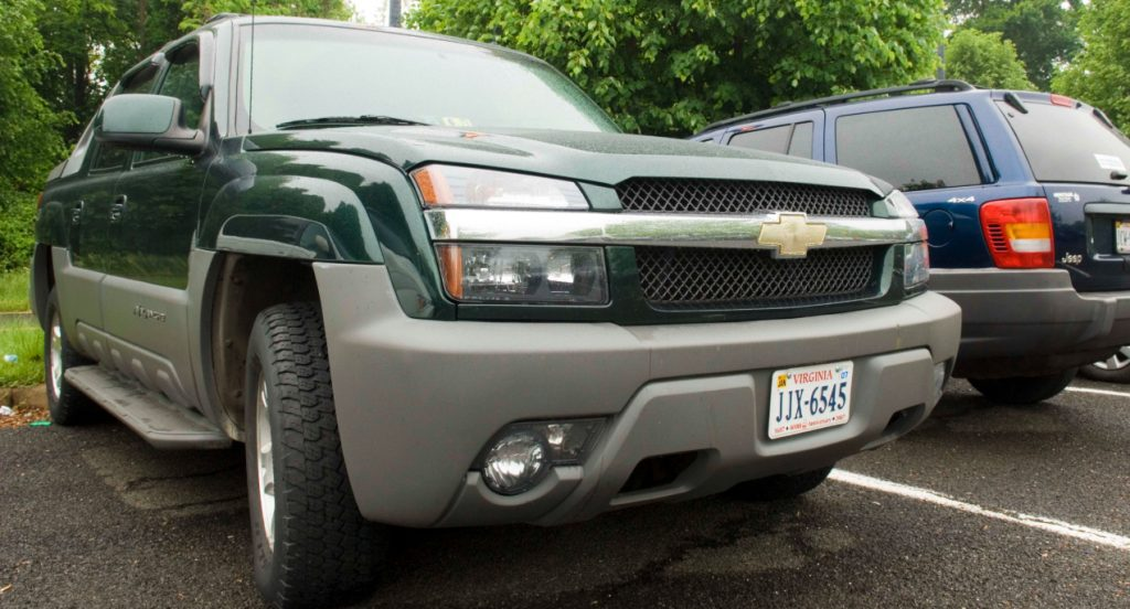 A green Chevrolet Avalanche in a commuter parking lot in Warrenton, Va.