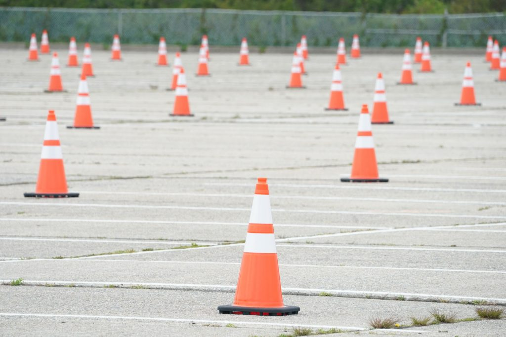 Cones Scattered Throughout Empty Parking Lot