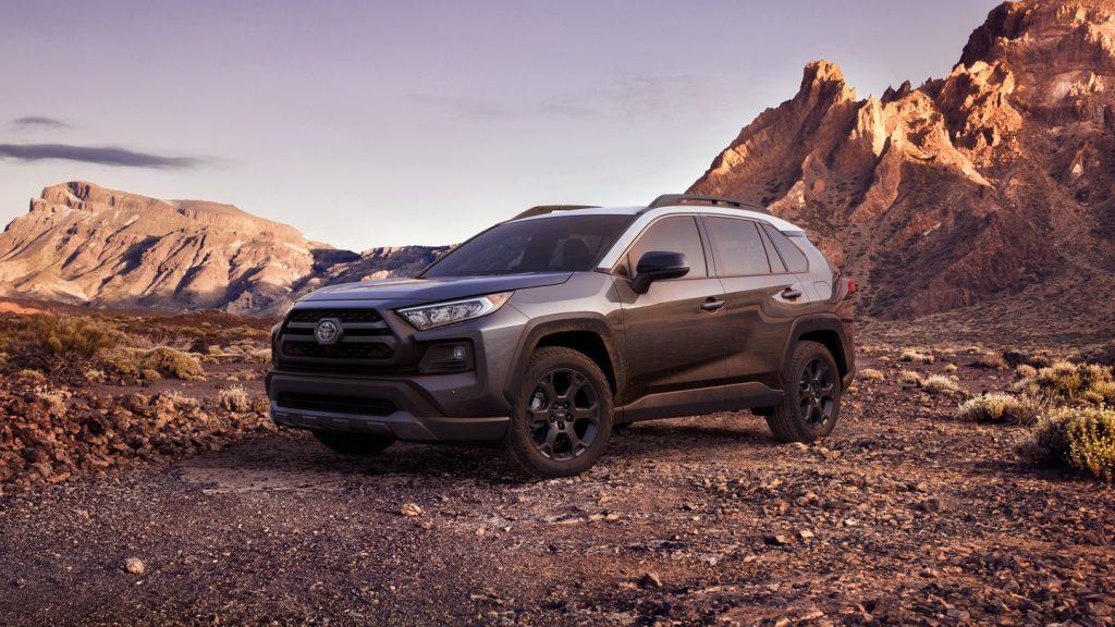 Dark gray Toyota RAV4 parked on desert terrain