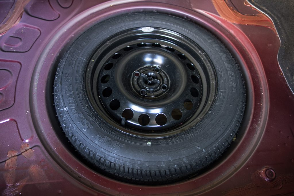 Donut Spare Tire Mounted In Car