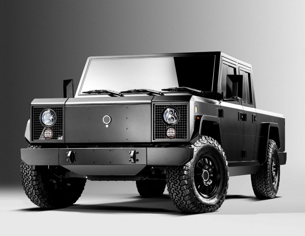 Driver's side front angle view of black Bollinger B2 electric pickup truck