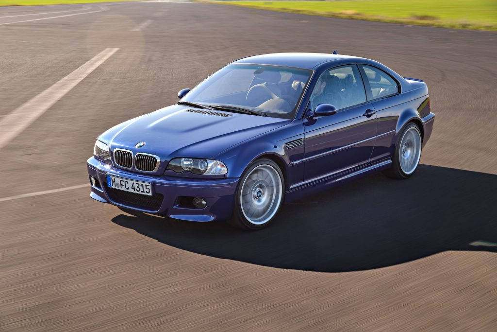 A blue E46 BMW M3 Competition going around a racetrack