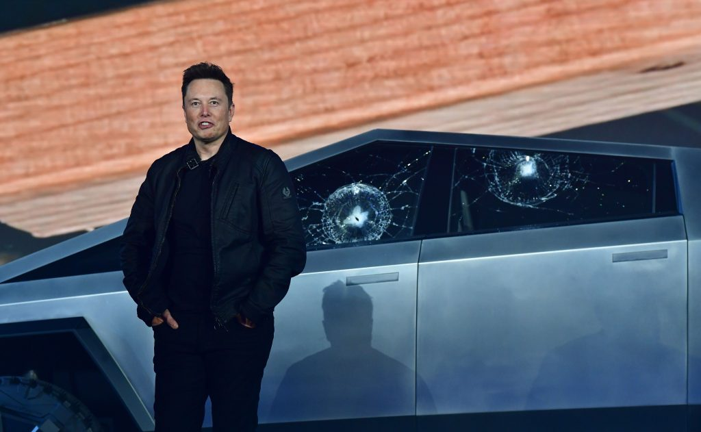 Elon Musk standing in front of Telsa Cybertruck