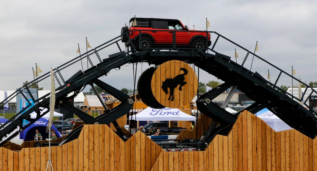 A red Ford Bronco on a test track during the Motor Bella event in Pontiac, Michigan on September 21, 2021.