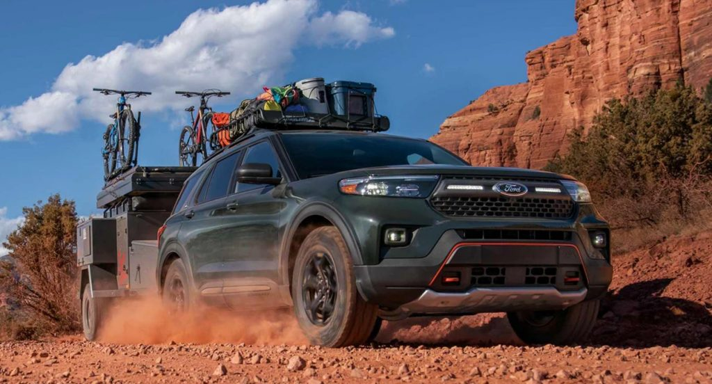 A black Ford Explorer Timberline is carrying a load and off-roading.