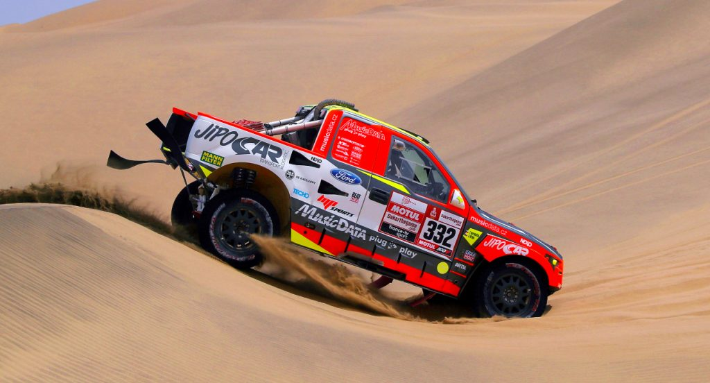 A red Ford Raptor RS Cross Country car driven by Tomas Ourednicek of The Czech Republic and David Kripal of The Czech Republic compete in the desert during Stage Two of the 2019 Dakar Rally between Pisco and San Juan de Marcona on January 7, 2019 in Pisco, Peru.