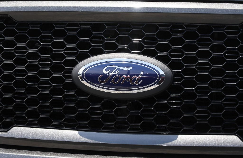 A Ford logo on a grill like what can be found on a Ford truck.