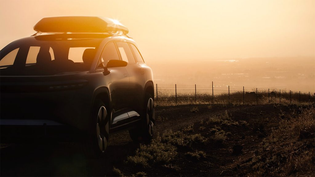 Front view of Lucid Gravity electric crossover SUV with the sunset in the background