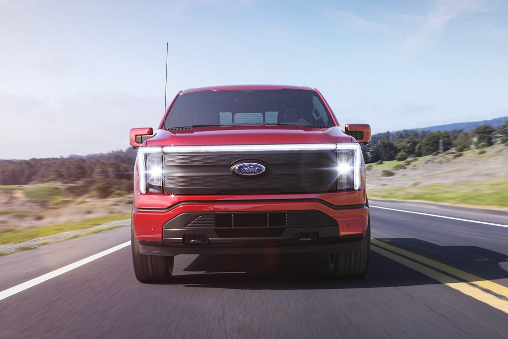 Front view of red 2022 Ford F-150 Lightning electric pickup truck