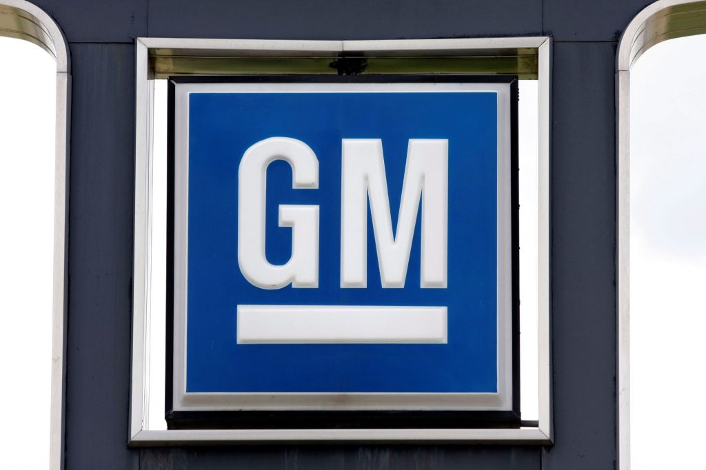 GM logo on a sign against a white background framed with black