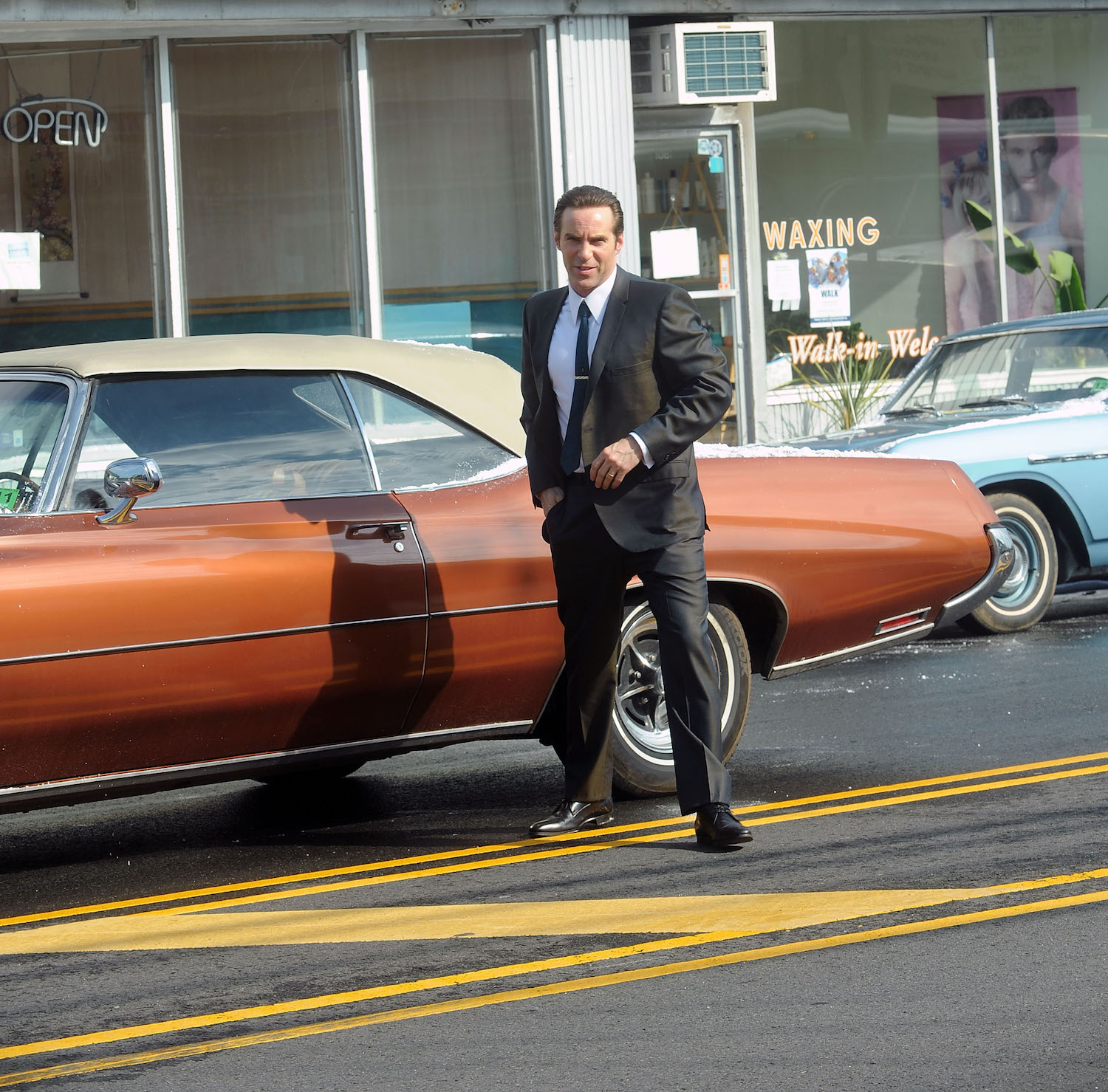 1971 Buick Centurion and actor Alessandro Nivola on the set. This is one of Dickie Moltisanti's Cars in the Many Saints of Newark Sopranos Prequel | Bobby Bank/GC Images