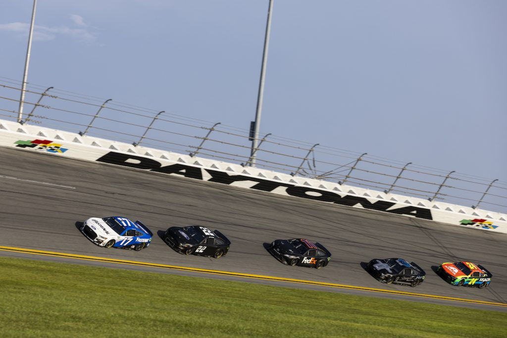 Chris Buescher, Driver of the #17 NASCAR Next Gen car, Joey Logano, Driver of the #22, Denny Hamlin, Driver of the #11, Cole Custer, Driver of the #41, and William Byron, Driver of the #24 test their Next Gen cars' drafting capabilities at Daytona International Speedway in Daytona Beach, Florida. The V8 NASCAR engines powering the Next Gen cars will be allowed to make hundreds more horsepower to battle the advanced aerodynamics of the new vehicles. | James Gilbert/Getty Images