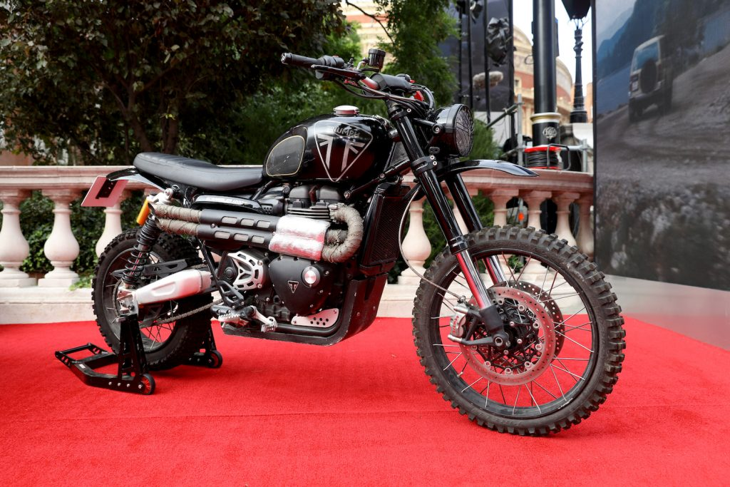 """James Bonds Triumph Motorcycle at the World Premiere of """"NO TIME TO DIE"""" The No Time To Die motorcycle completed an incredible two story jump in Matera Italy, using coca-cola 
