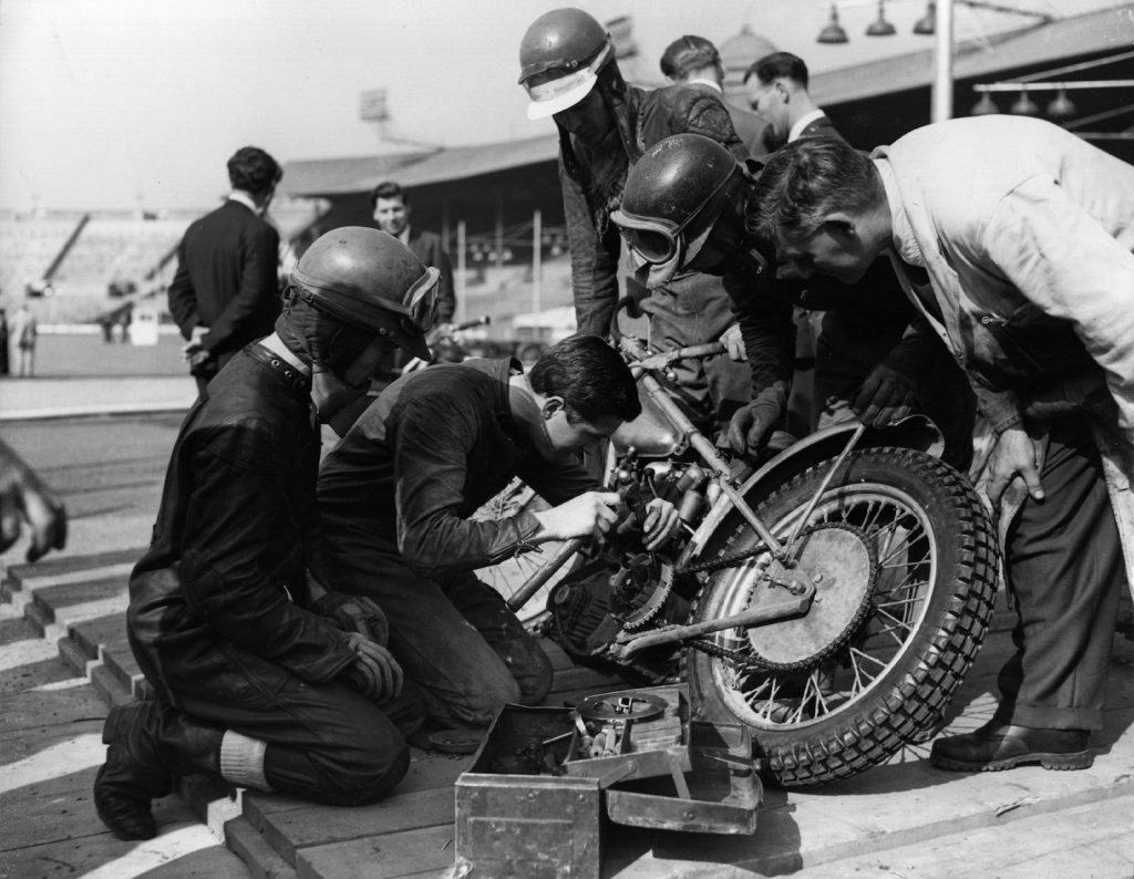 World speedway champion Barry Briggs repairs his motorcycle in the pits at Wembley, London, in 1958. Slow leaks have always been an annoying problem, but you can use soap to find a slow tire leak or valve stem leak.   Fox Photos/Getty Image