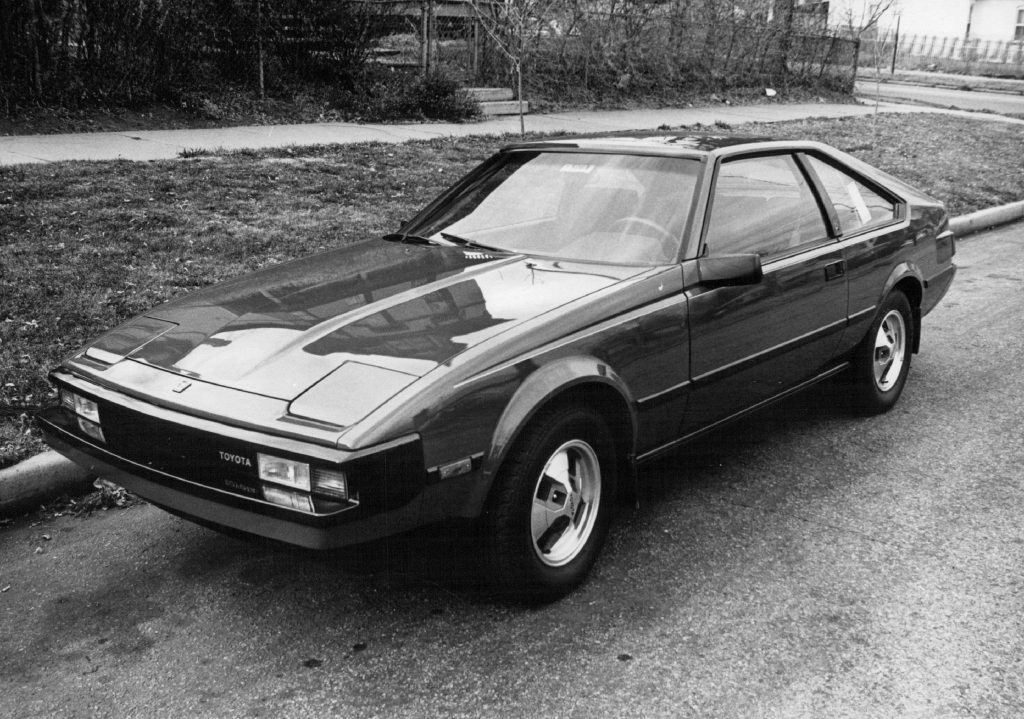 An 1982 Toyota Supra in an old black and white photo. This is a perfect example of a fun and affordable used car with a manual transmission
