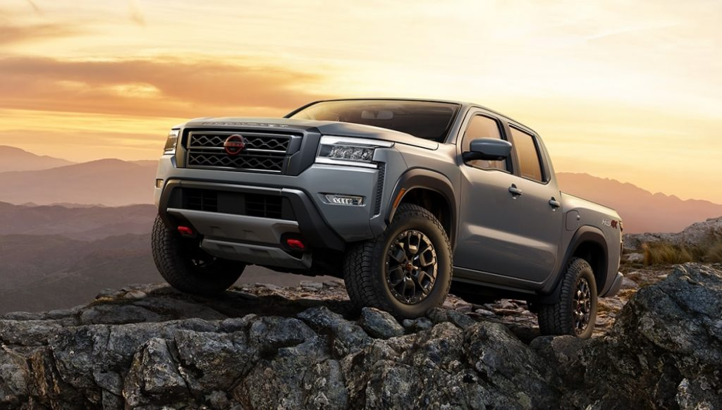 Gray 2022 Nissan Frontier parked on some rocks