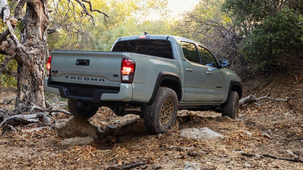 Gray 2022 Toyota Tacoma driving on rocky terrain