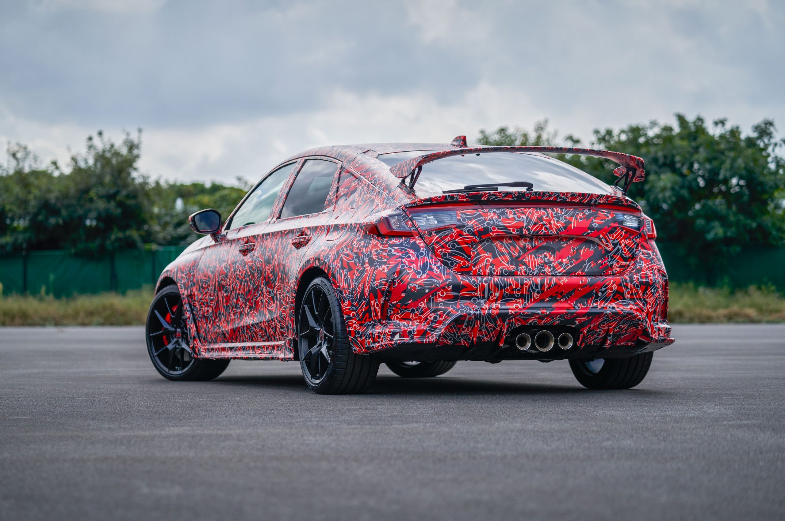 The rear 3/4 of the 2023 Honda Civic Type R at the Nurburgring